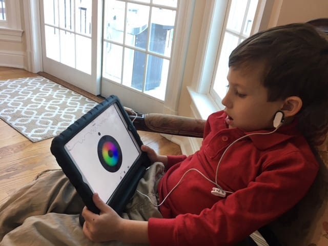 Young boy with tablet - Neurofeedback - Biofeedback