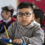 young boy at school with ADHD learning disability