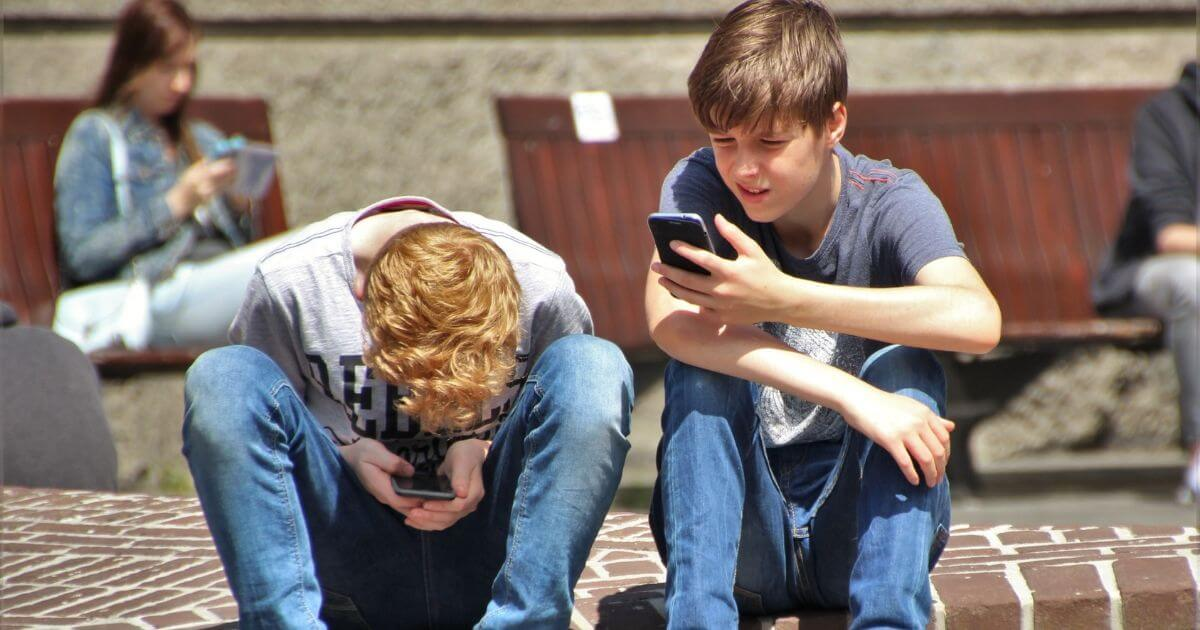 Young Boys with ADHD distracted by cellphone