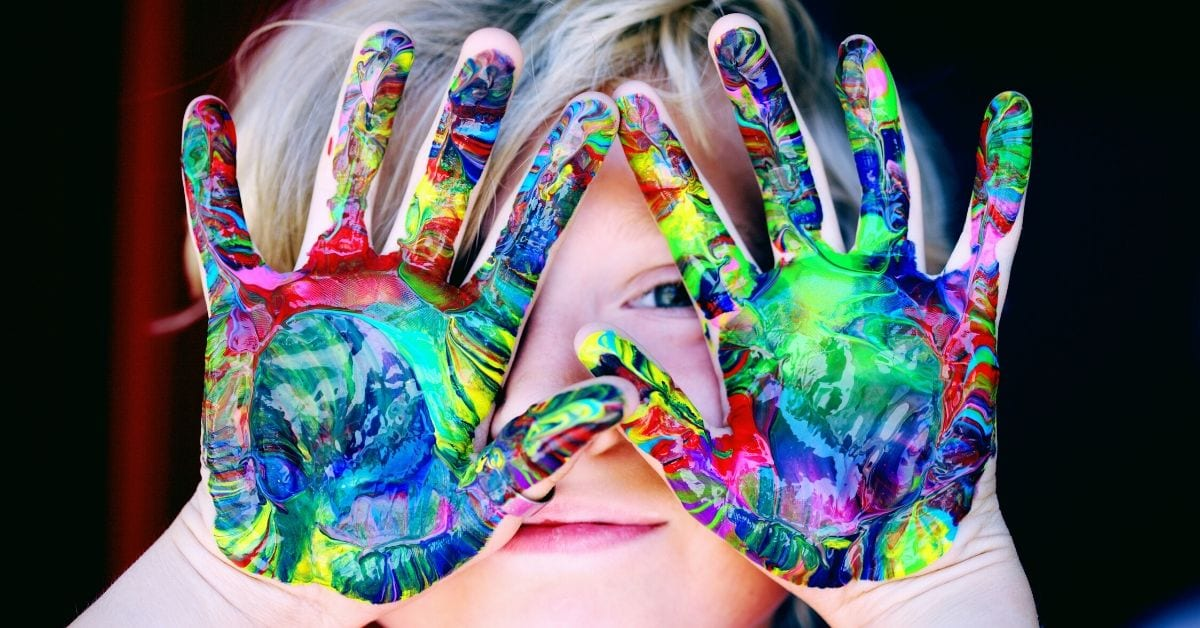 child with creative hand paint