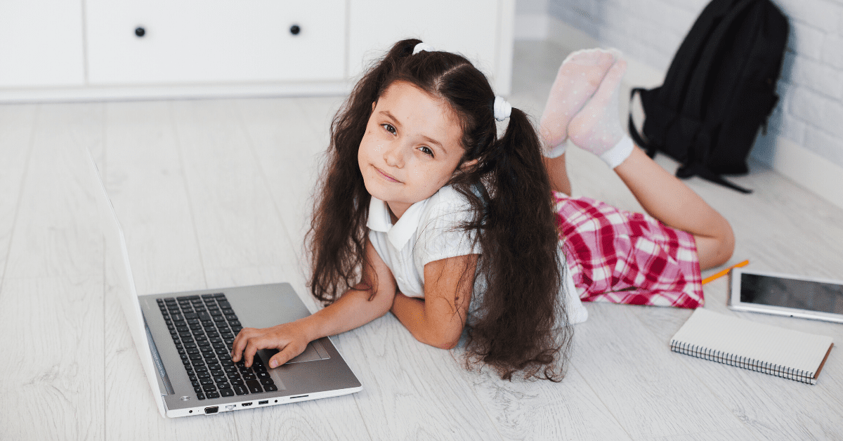 girl-laying-with-laptop