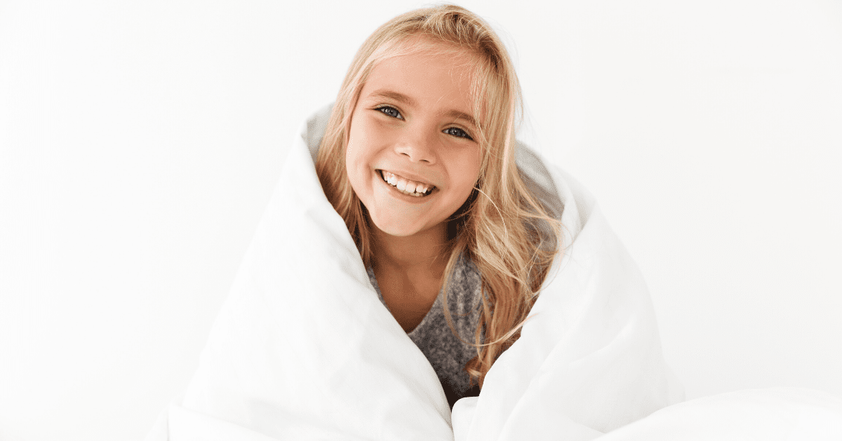 smiling-girl-with-blanket