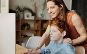 mom and son using computer - Dr. Roseann